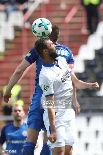 Daniel Gordon of Karlsruher SC and Souifan Benyamina of Hansa Rostock during the 3 Liga match between Karlsruher SC and FC Hansa Rostock at on April...