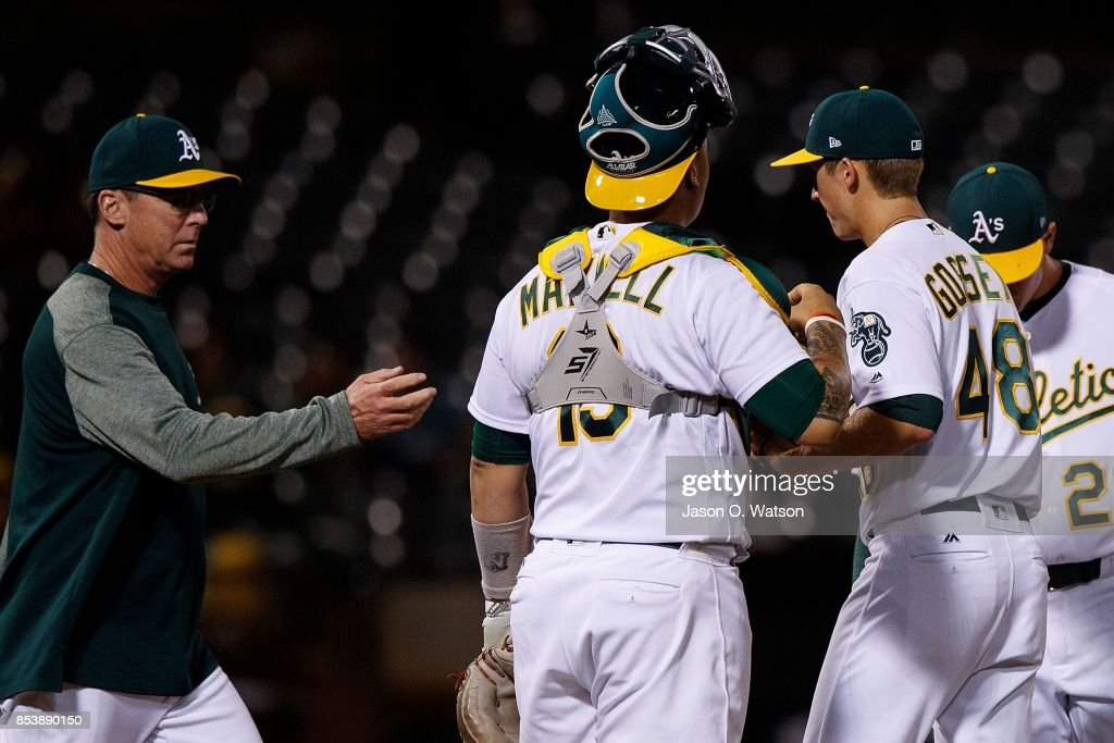 Daniel Gossett #48 of the Oakland Athletics is relieved by manager Bob Melvin #6 during the fifth inning against the Seattle Mariners at the Oakland Coliseum on September 25, 2017 in Oakland, California. The Seattle Mariners defeated the Oakland Athletics 7-1.