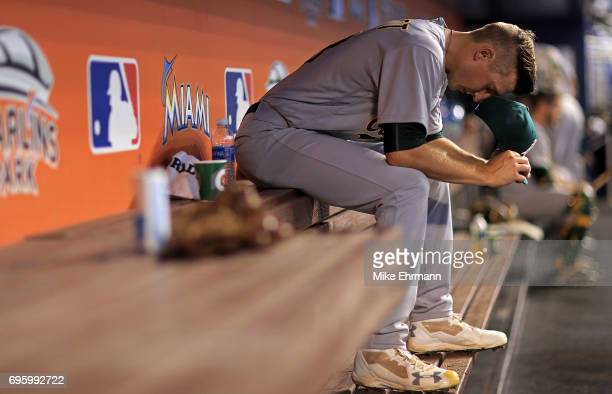 Daniel Gossett of the Oakland Athletics takes a moment before his first major league start during a game against the Miami Marlins at Marlins Park on...