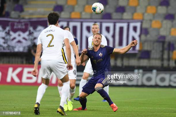 Daniel Granli of AIK and Andrej Kotnik on Maribor in action during the Second qualifying round of the UEFA Champions League between NK Maribor and...