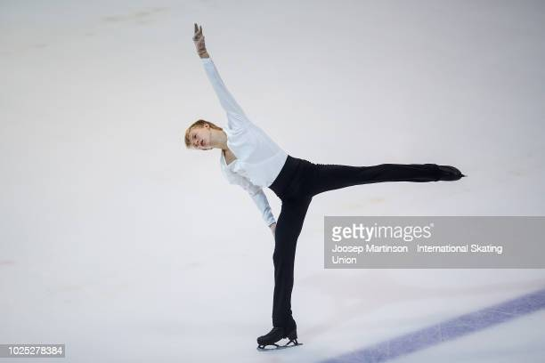 Daniel Grassl of Italy competes in the Junior Men Short Program during day one of the ISU Junior Grand Prix of Figure Skating at Keine Sorgen Eis...