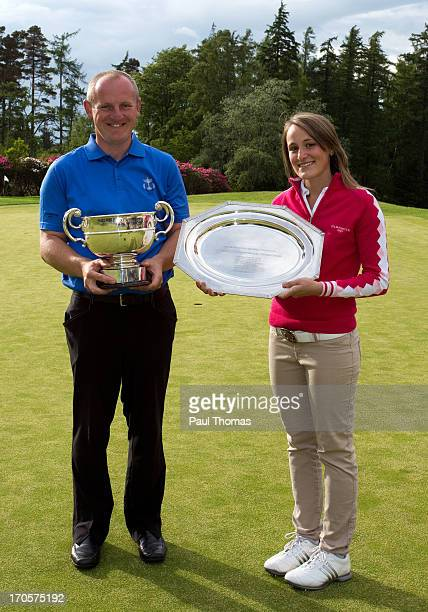 Daniel Greenwood of Forest Pines Golf Club and Lucy Williams of Mid Herts Golf Club pose for a photograph with their trophies after the final round...