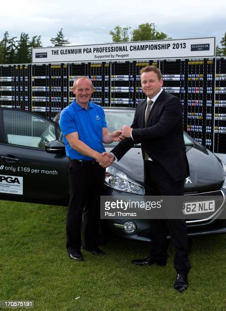 Daniel Greenwood of Forest Pines Golf Club is handed the keys to a new Peugeot car after winning the Glenmuir PGA Professional Championship on the...