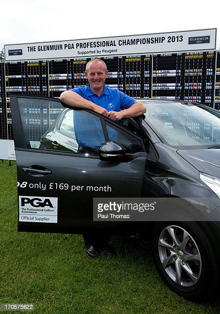 Daniel Greenwood of Forest Pines Golf Club poses for a photograph with a Peugeot car after winning the Glenmuir PGA Professional Championship on the...