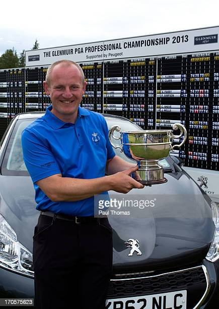 Daniel Greenwood of Forest Pines Golf Club poses for a photograph with the trophy and Peugeot car after winning the Glenmuir PGA Professional...