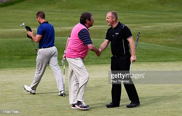 Daniel Greenwood of Forest Pines Golf Club shakes hands with his caddie on the 18th green during the final round of the Glenmuir PGA Professional...