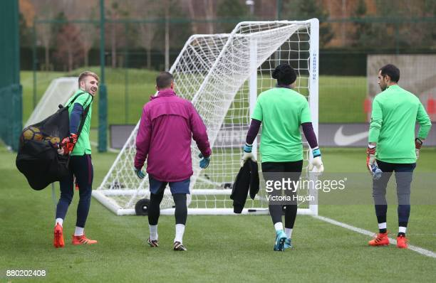 Daniel Grimshaw Ederson Moraes Claudio Bravo and coach Andrew Mulliner walk to training at Manchester City Football Academy on November 27 2017 in...