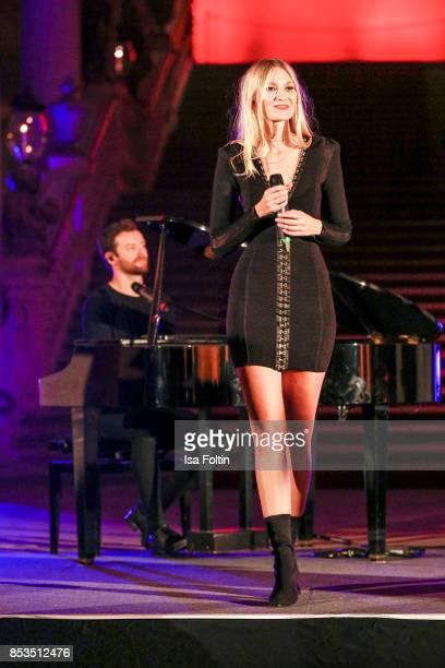 Daniel Grunenberg and Carolin Niemczyk perform during the Minx Fashion Night in favour of 'Sauti Kuu' of Auma Obama at Wuerzburger Residenz on...
