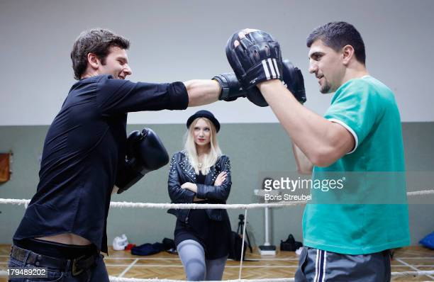 Daniel Grunenberg of the pop band Glasperlenspiel in action against WBO Cruiserweight champion Marco Huck of Germany in the ring of his training camp...