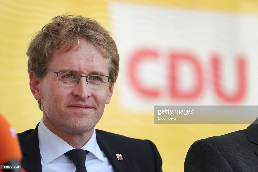 Daniel Guenther, lawmaker of the Christian Democrat Union (CDU) and state premier of Schleswig-Holstein state, looks on during an election campaign stop in Saint Peter-Ording, Germany, on Monday, Aug. 21, 2017. Germany's Chancellor and CDU leader Angela Merkel headed out on the campaign trail last week and quickly faced disruption by anti-immigration demonstrators, a reminder that the refugee crisis that sent her popularity plunging in 2016 remains a residual risk. Photographer: Krisztian Bocsi/Bloomberg via Getty Images