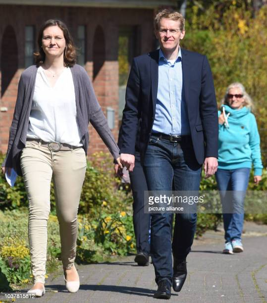 Daniel Guenther leading candidate of the CDU party and his wife Anke arrive at a polling station in Eckernfoerde Germany 7 May 2017 232 million...