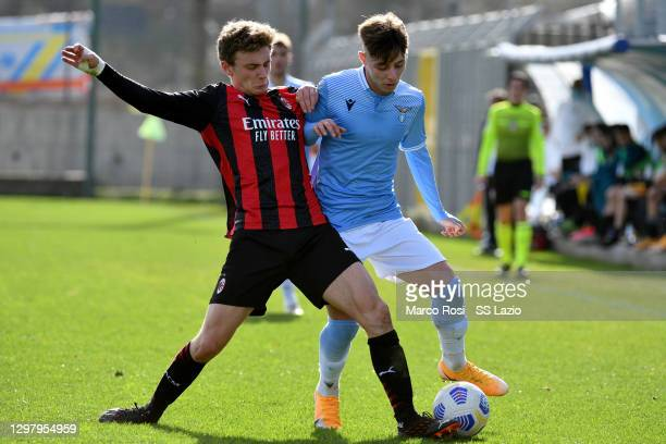 Daniel Guerini of SS Lazio compete for the ball with Lucas Stanga of AC Milan during the Primavera 1 TIM match between SS Lazio U19 and AC Milan U19...