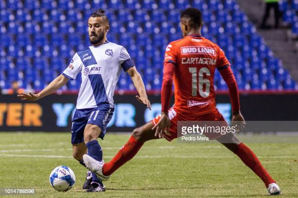Daniel Guerrero of Puebla and Wilder Cartagena of Veracruz fight for the ball during the 4th round match between Puebla and Veracruz as part of the...