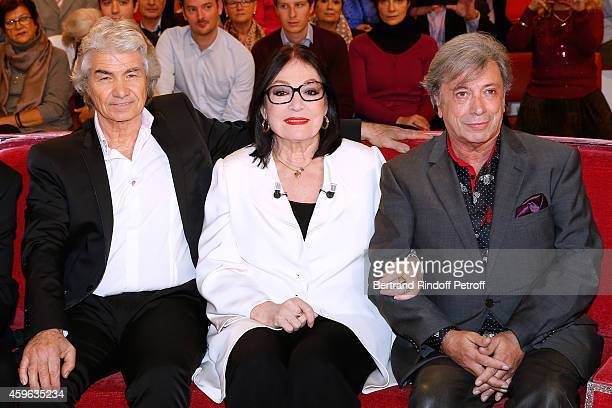 Daniel Guichard Nana Mouskouri and Herve Vilard attend the 'Vivement Dimanche' French TV Show at Pavillon Gabriel on November 26 2014 in Paris France