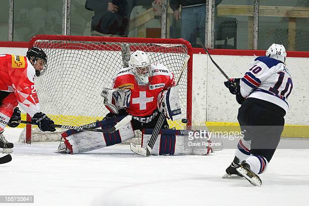 Daniel Guntern of team Switzerland makes a save on Evan Allen from team USA during game two of the U-18 Four Nations Cup on November 7, 2012 at the...