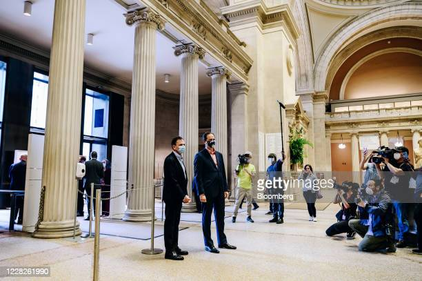Daniel H. Weiss and Max Hollein prepare to greet visitors during the public reopening at the Metropolitan Museum of Art in New York, U.S., on...