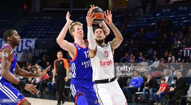 Daniel Hackett, #0 of Brose Bamberg competes with Brock Motum, #12 of Anadolu Efes Istanbul during the 2017/2018 Turkish Airlines EuroLeague Regular...
