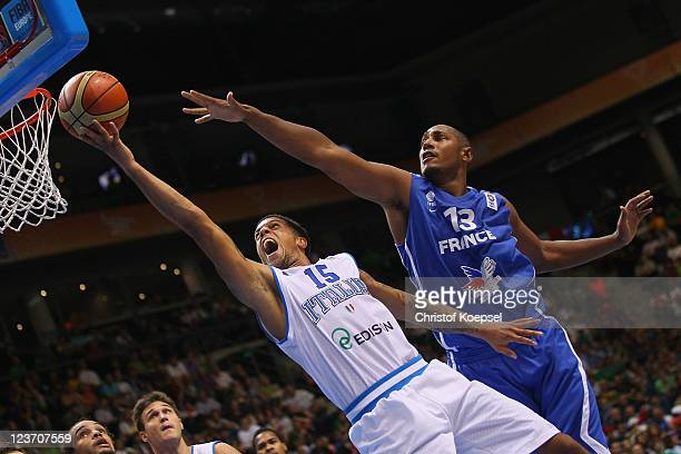 Daniel Hackett of Italy shoots over Boris Diaw of France during the EuroBasket 2011 first round group B match between Italy and France at Siauliai...