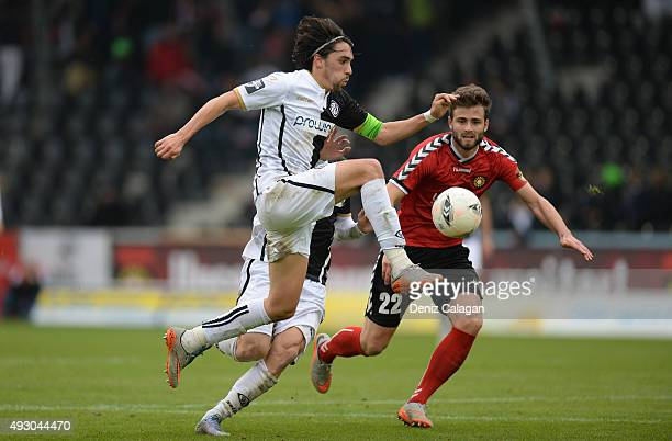 Daniel Haegele of Grossaspach challenges Markus Schwabl of Aalen during the Third League match between SG Sonnenhof Grossaspach and VfR Aalen at...