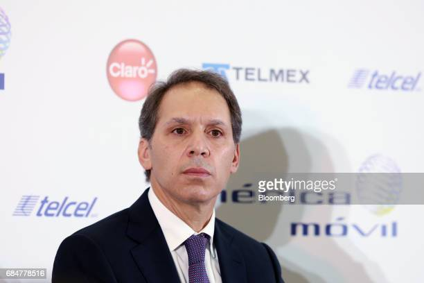 Daniel Hajj chief executive officer of American Movil SAB listens during a press conference at the company's headquarters in Mexico City Mexico on...