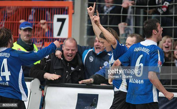 Daniel Halfar Leonidas Kampantais and Markus Bollmann of Bielefeld celebrate their goal during the Bundesliga match between Arminia Bielefeld and...