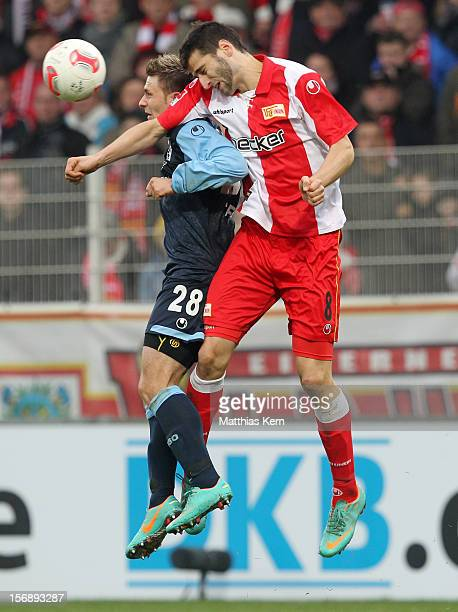 Daniel Halfar of Muenchen and Markus Karl of Berlin jump for a header during the Second Bundesliga match between 1FC Union Berlin and TSV 1860...