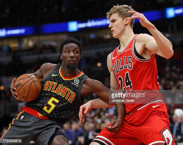Daniel Hamilton of the Atlanta Hawks moves against Lauri Markkanen of the Chicago Bulls at the United Center on January 23 2019 in Chicago Illinois...