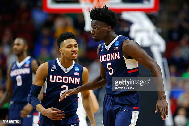 Daniel Hamilton of the Connecticut Huskies reacts with Jalen Adams after a dunk in the second half against the Colorado Buffaloes during the first...