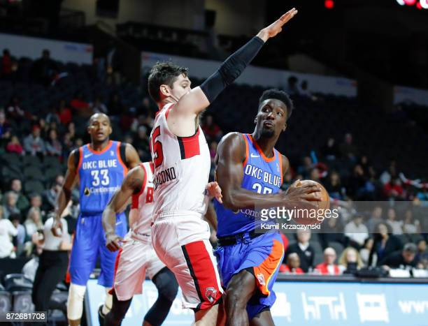 Daniel Hamilton of the Oklahoma City Blue drives to the basket against Ryan Arcidiacono of the Windy City Bulls during the first quarter of an NBA...