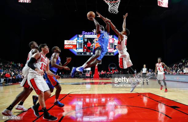 Daniel Hamilton of the Oklahoma City Blue goes to the basket against Jarell Eddie of the Windy City Bulls during the second half of an NBA GLeague...