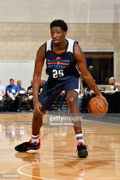 Daniel Hamilton of the Oklahoma City Thunder dribbles the ball against the Indiana Pacers during the Mountain Dew Orlando Pro Summer League on July 6...