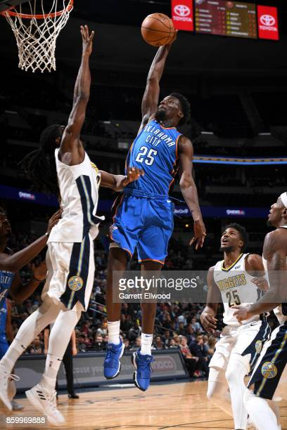 Daniel Hamilton of the Oklahoma City Thunder goes to the basket against the Denver Nuggets on October 10 2017 at the Pepsi Center in Denver Colorado...