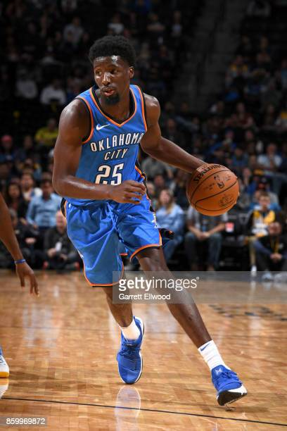 Daniel Hamilton of the Oklahoma City Thunder handles the ball against the Denver Nuggets on October 10 2017 at the Pepsi Center in Denver Colorado...