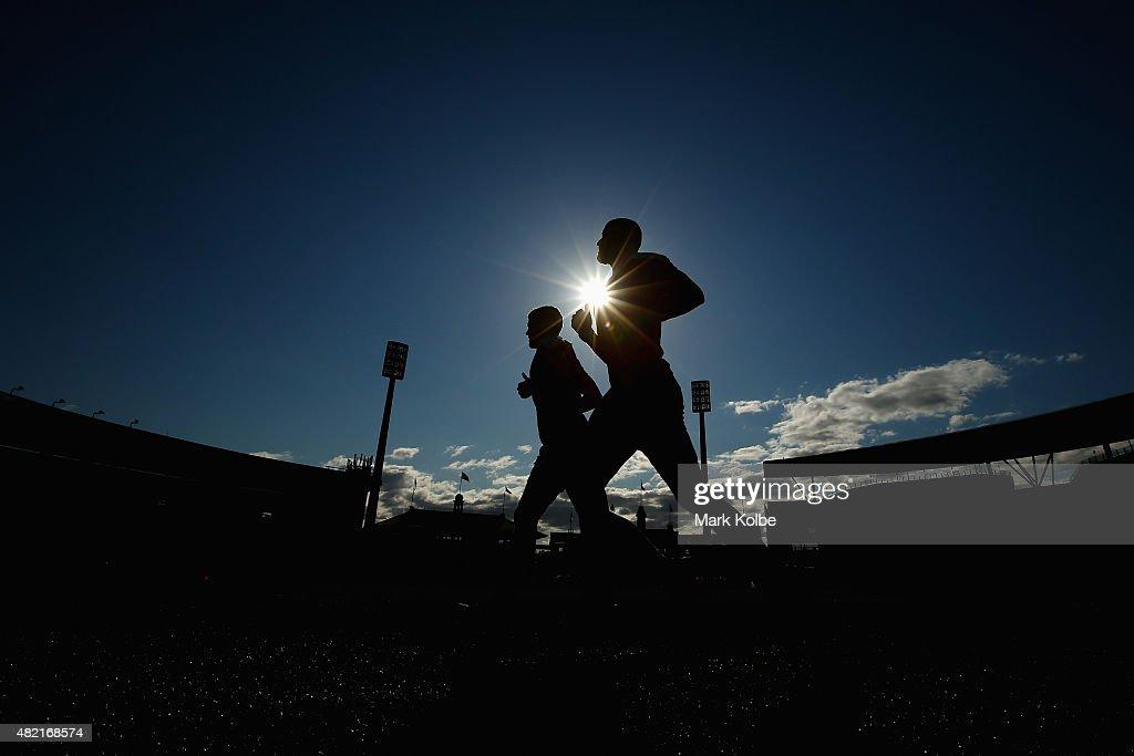 Daniel Hannebery and Rhyce Shaw run during a Sydney Swans AFL training session at the Sydney Cricket Ground on July 28, 2015 in Sydney, Australia.