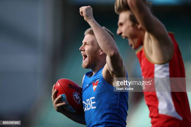 Daniel Hannebery celebrates winning a training drill with his group during a Sydney Swans AFL training session at Sydney Cricket Ground on June 13...