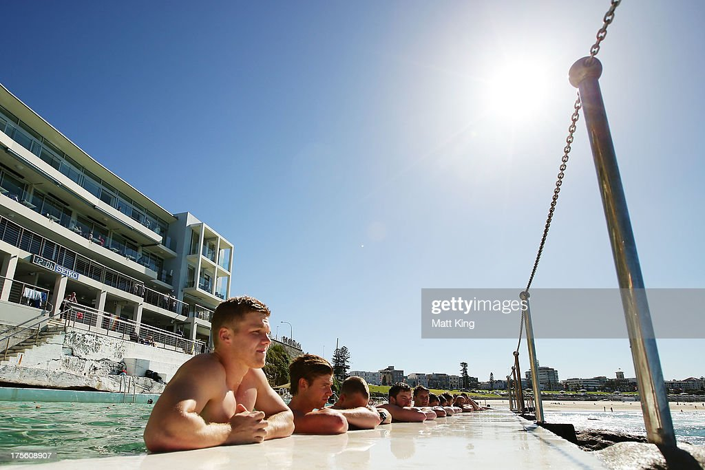 Daniel Hannebery (L) cools his legs during a Sydney Swans AFL recovery session at Bondi Icebergs Pool on August 5, 2013 in Sydney, Australia.