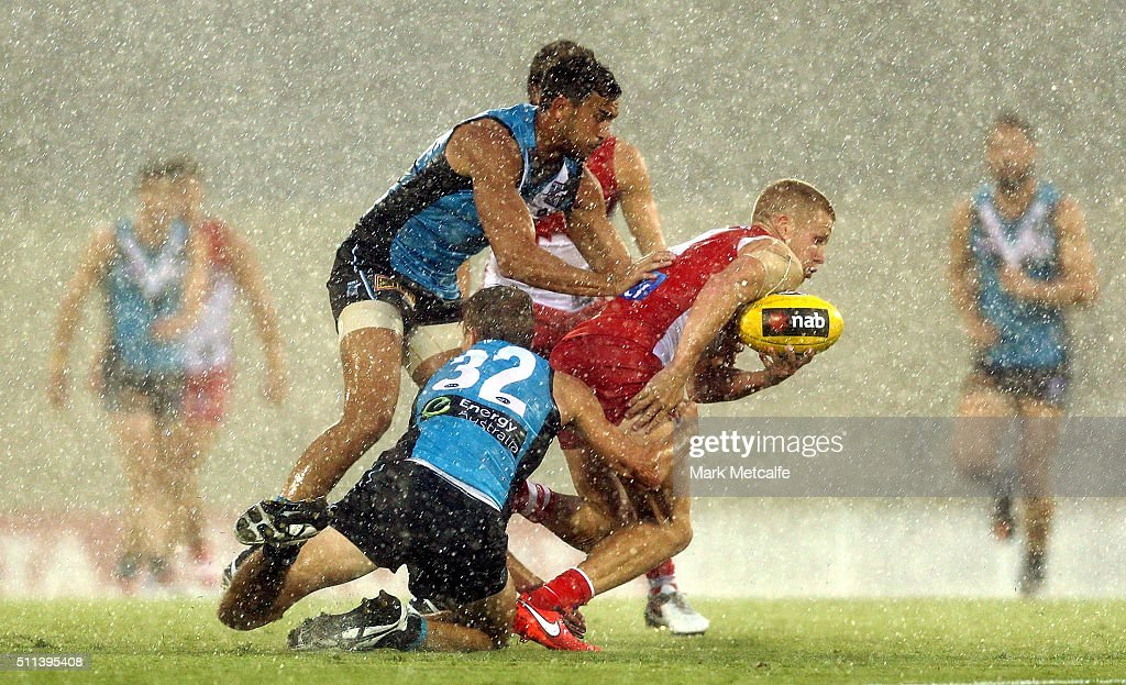 Daniel Hannebery of the Swans is tackled by Dougal Howard of the Power during the 2016 NAB Challenge AFL match between the Sydney Swans and Port Adelaide Power at Blacktown International Sportspark on February 20, 2016 in Sydney, Australia.