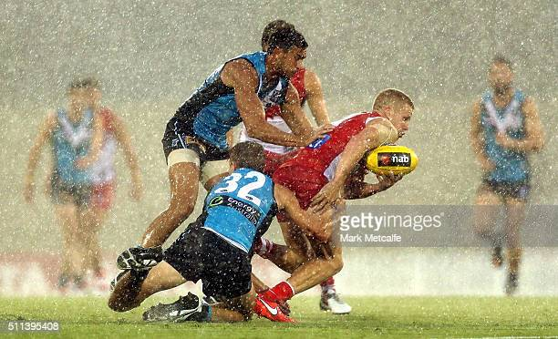Daniel Hannebery of the Swans is tackled by Dougal Howard of the Power during the 2016 NAB Challenge AFL match between the Sydney Swans and Port...