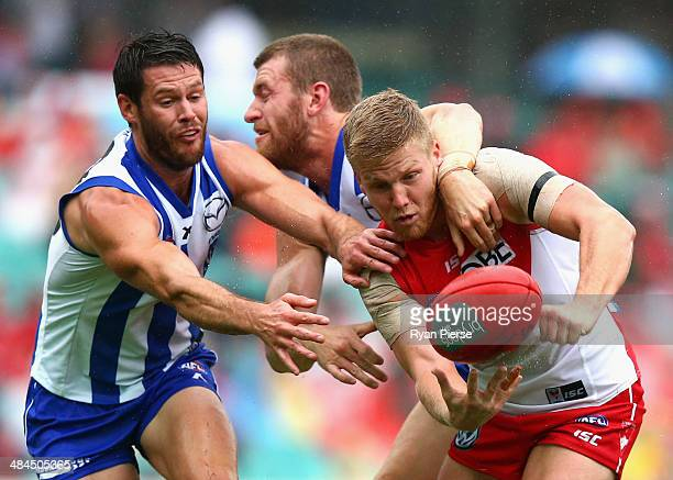 Daniel Hannebery of the Swans is tackled by Lachlan Hansen of the Kangaroos during the round four AFL match between the Sydney Swans and the North...