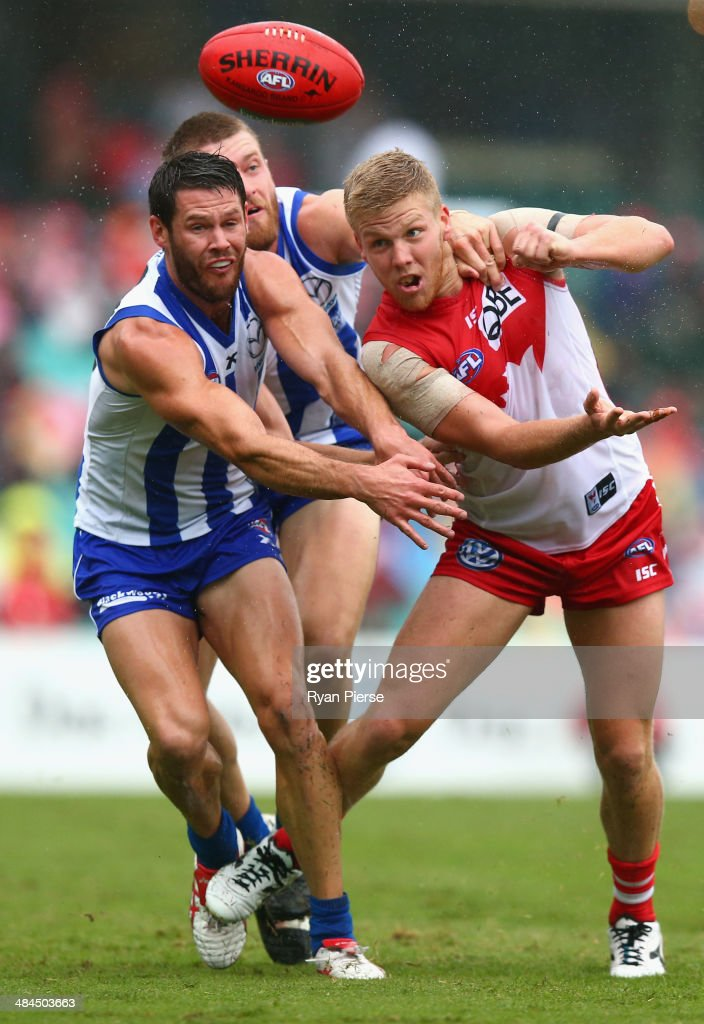 Daniel Hannebery of the Swans is tackled by Sam Gibson of the Kangaroos during the round four AFL match between the Sydney Swans and the North Melbourne Kangaroos at Sydney Cricket Ground on April 13, 2014 in Sydney, Australia.