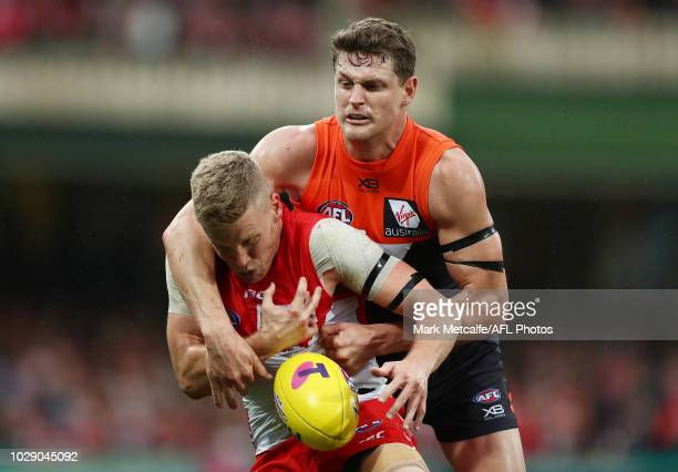 Daniel Hannebery of the Swans is tackled during the AFL Second Elimination Final match between the Sydney Swans and the GWS Giants at Sydney Cricket...