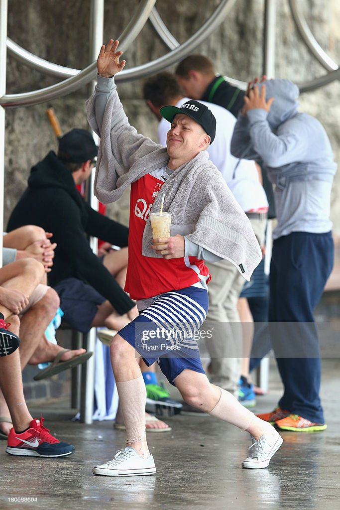 Daniel Hannebery of the Swans stretches during a recovery session at Coogee Beach on September 15, 2013 in Sydney, Australia.