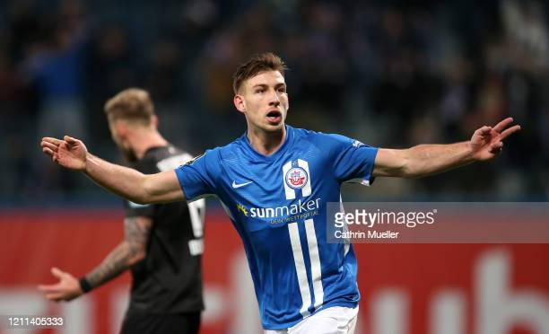 Daniel Hanslik of Hansa Rostock celebrates after scoring during the 3. Liga match between Hansa Rostock and Eintracht Braunschweig at Ostseestadion...