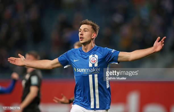 Daniel Hanslik of Hansa Rostock celebrates after scoring during the 3 Liga match between Hansa Rostock and Eintracht Braunschweig at Ostseestadion on...