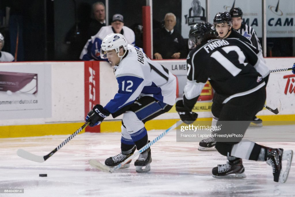 Daniel Hardie #12 of the Saint John Sea Dogs controls the puck against Giordano Finoro #17 of the Gatineau Olympiques on December 1, 2017 at Robert Guertin Arena in Gatineau, Quebec, Canada.