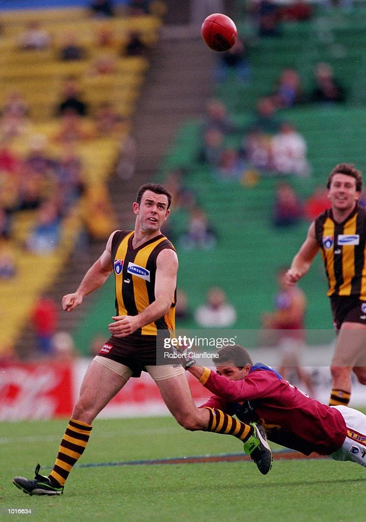 Daniel Harford of Hawthorn is caught by Darryl White of Brisbane, in the match between Hawthorn and the Brisbane Lions, during round five of the AFL season, played at Waverley Park, Melbourne, Australia. Mandatory Credit: Robert Cianflone/ALLSPORT