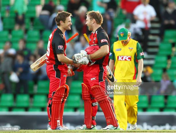 Daniel Harris and Aiden Blizzard of the Redbacks celebrate winning the Twenty20 Big Bash match between the Tasmanian Tigers and the South Australian...