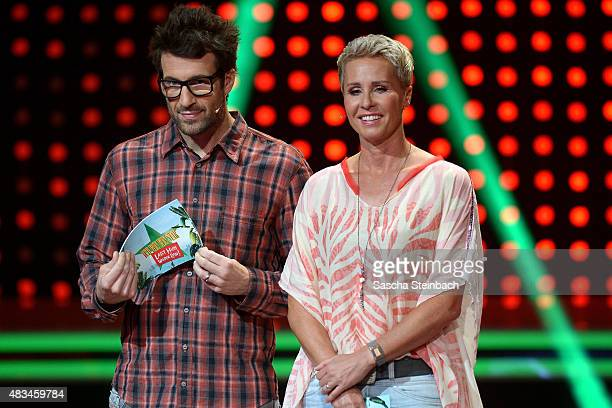 Daniel Hartwich and Sonja Zietlow look on during the final of the television show 'Ich bin ein Star lasst mich wieder rein' on August 8 2015 in...