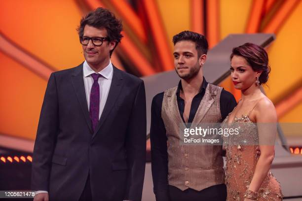 Daniel Hartwich Christina Luft and Luca Haenni looks on during the 2nd show of the 13th season of the television competition Let's Dance on March 6...