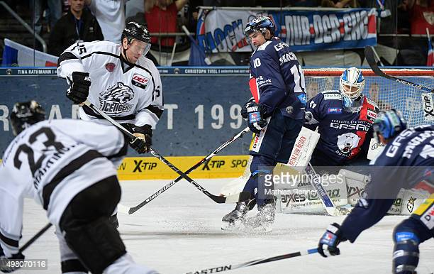 Daniel Heatley of the Thomas Sabo Ice Tigers Nuernberg Spencer Machacek and Petri Vehanen of the Eisbaeren Berlin during the game between the...
